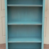 Tall Bookshelf in distressed Sea Blue. Three adjustable shelves.
