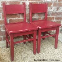 "Matching pair of solid oak kids chairs refinished in distressed barn red, with black glaze accenting wood grain. Chair backs 23"" tall. Sold as pair. Call Jeff at 979-575-7627 to purchase."