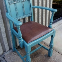 Old Oak Arm Chair in distressed Sea Blue and Black Glaze. From Facelift Furniture's DIY Inspiration album.