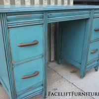 Vanity Desk in distressed Sea Blue with Black Glaze.  Original drawer pulls.  From Facelift Furniture's DIY Inspiration album.