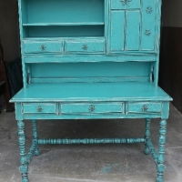 Ornate Vintage Desk with Hutch in Turquoise with Black Glaze.  Distressing reveals original red-orange color. From Facelift Furniture's DIY Inspiration album.