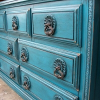Ornate Dresser in distressed Peacock Blue with Black Glaze. Original drawer pulls. From Facelift Furniture's DIY Inspiration album.