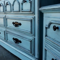 Dresser & Nightstand in distressed Robin's Egg Blue with Black Glaze.  Original pulls painted black. From Facelift Furniture's DIY Inspiration album.