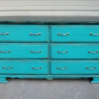 Oak Dresser painted Turquoise, with Black Glaze heavier on the top. The glaze worked into oak grain enhances the weathered look of rustic this piece. From Facelift Furniture's DIY Inspiration album.