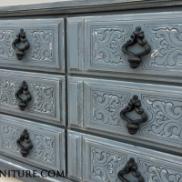 Ornate Dresser in Slate Blue with Black Glaze, distressed down to white primer. Original pulls painted black. From Facelift Furniture's DIY Inspiration album.