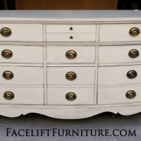 Dresser custom painted Off White with Tobacco Glaze and light distressing.  Original pulls.  From Facelift Furniture's DIY Inspiration album.