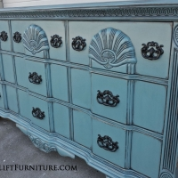Ornate Dresser in distressed Sea Blue, with Black Glaze and pulls painted Black.  Re-purposed as a media console. From Facelift Furniture's DIY Inspiration album.