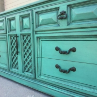 Large retro dresser in with beveled drawers and lattice work door.  Painted Jade, with Black Glaze.