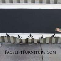 Headboard repurposed into coat rack and chalkboard. Furniture's Repurposed Wall Pieces collection.