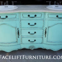 "Curvy French Bathroom Vanity custom painted ""Sweet Rhapsody"", a light turquoise (Behr, Home Depot) accented with Black Glaze and distressed. Original hardware. From Facelift Furniture's DIY Inspiration album."